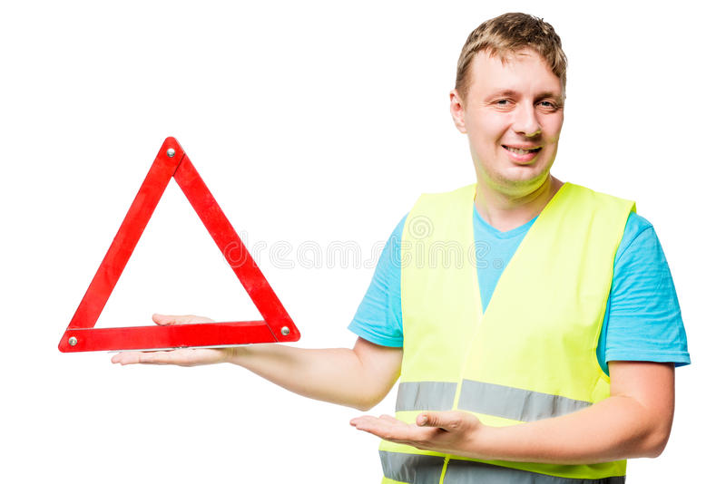 Happy mechanic demonstrates emergency stop sign on white royalty free stock photo