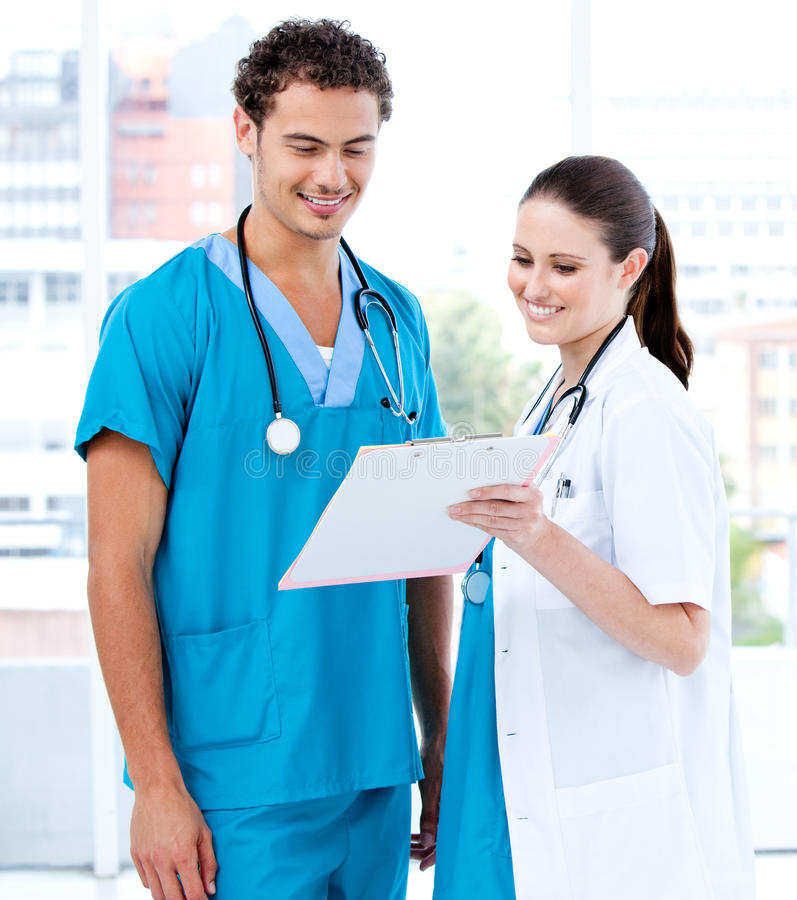 Download Happy Medical Partners Looking At The Diagnosis Stock Photo - Image: 14259258