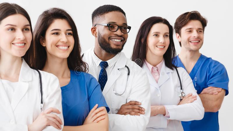 Happy Medical Staff Standing Together In Clinic royalty free stock images