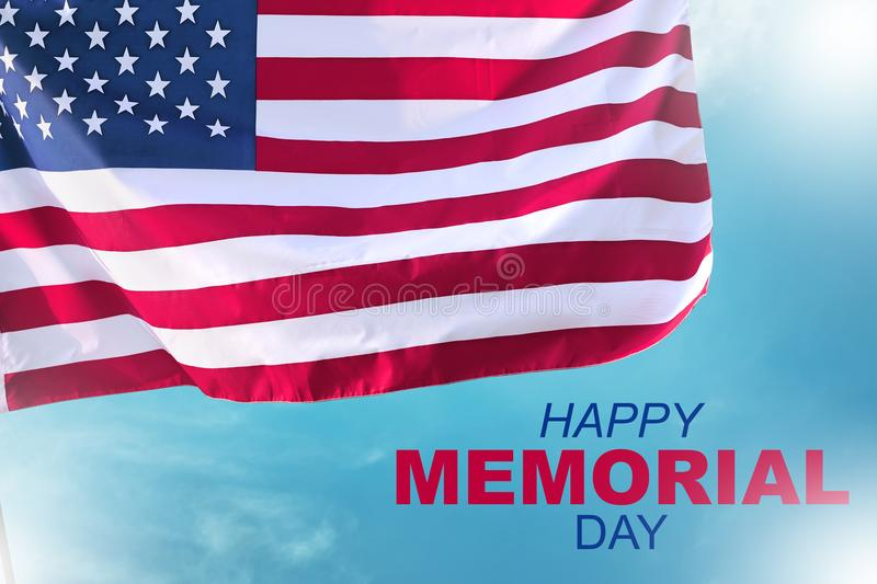 Happy memorial day with american flag waving. Over blue sky background royalty free stock photo