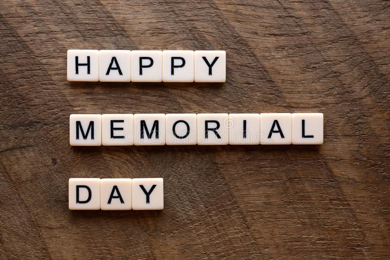 Happy memorial day with scrabble letters royalty free stock photography