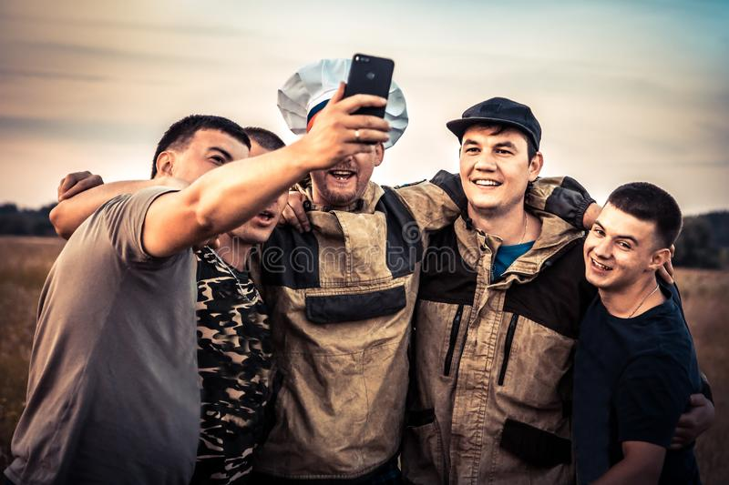 Happy men friends making group selfie photography concept strong male friendship lifestyle stock photography