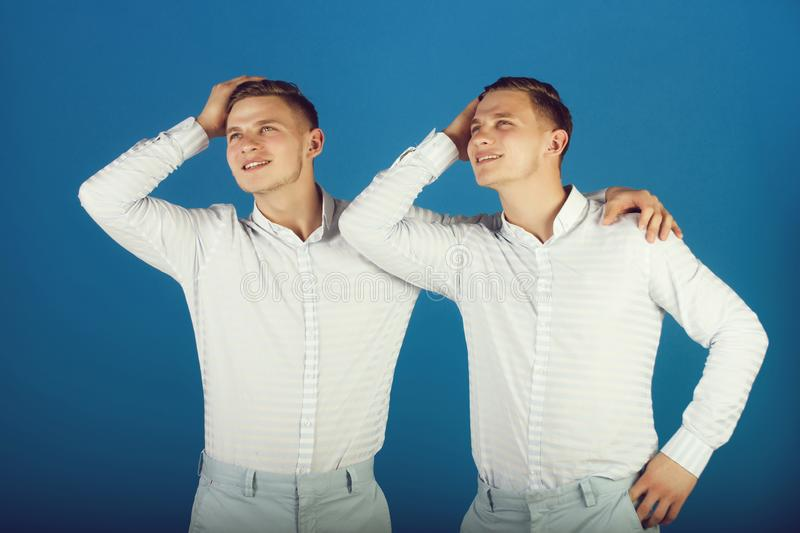Happy men hugging and touching hair royalty free stock images