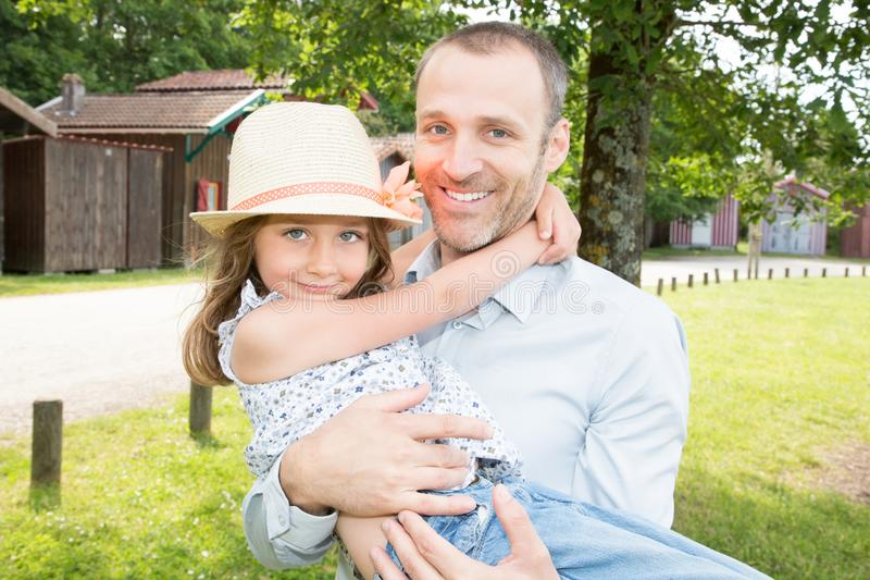 Happy man and little girl in having fun in summer. Happy men and little girl in having fun in summer park royalty free stock image