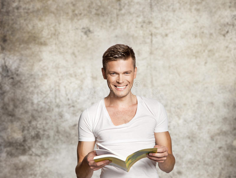 Happy men reading. Happy man reading a book royalty free stock images
