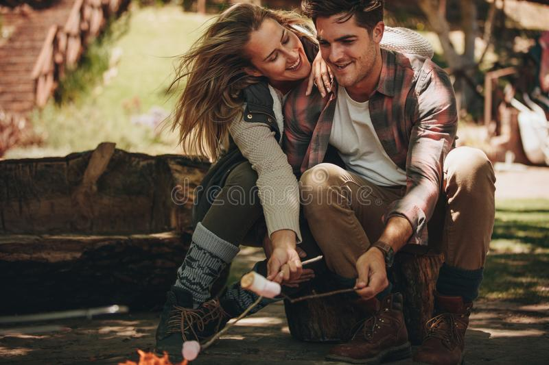 Couple having a great time on camping stock photo