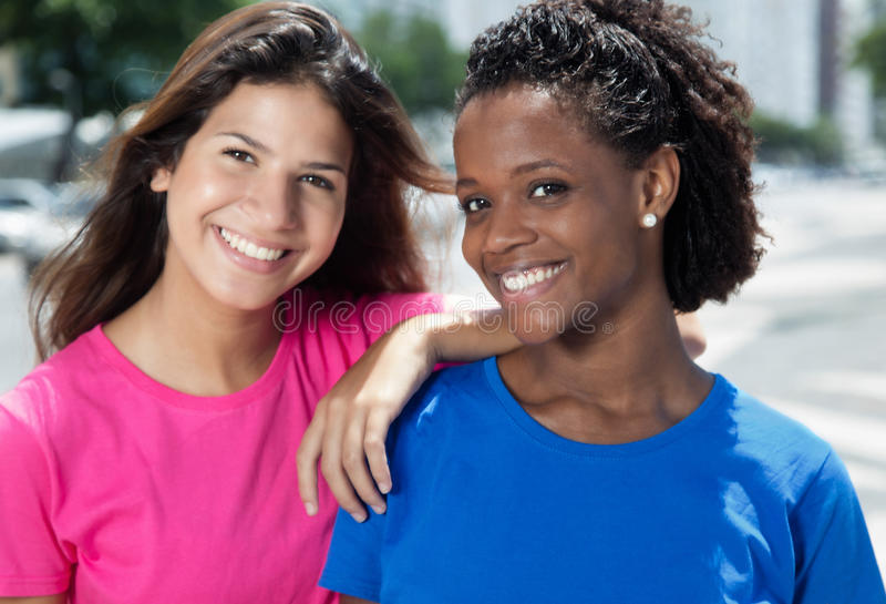 Happy mexican girl with caucasian woman stock photography