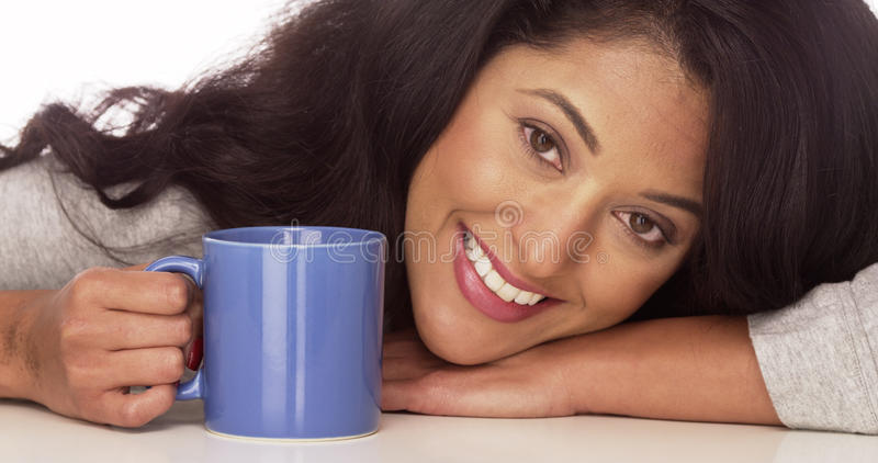 Happy Mexican woman with coffee royalty free stock photography