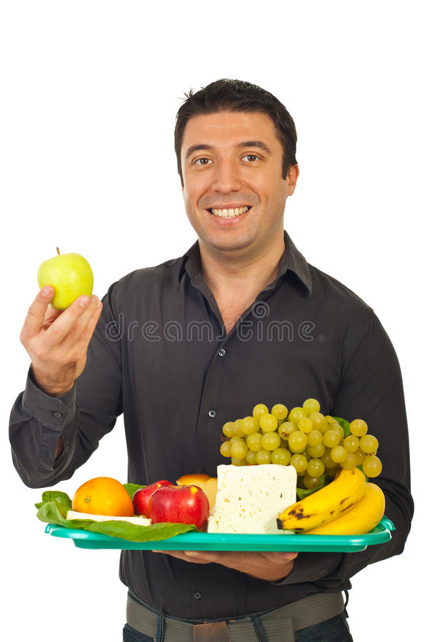 Happy mid adult man choose green apple stock images