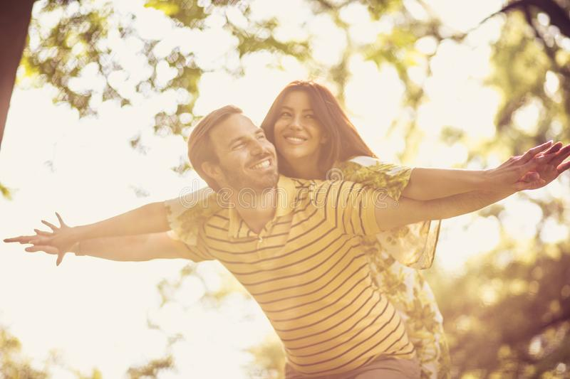 Happy middle age couple have fun at nature. Beauty in nature royalty free stock photography