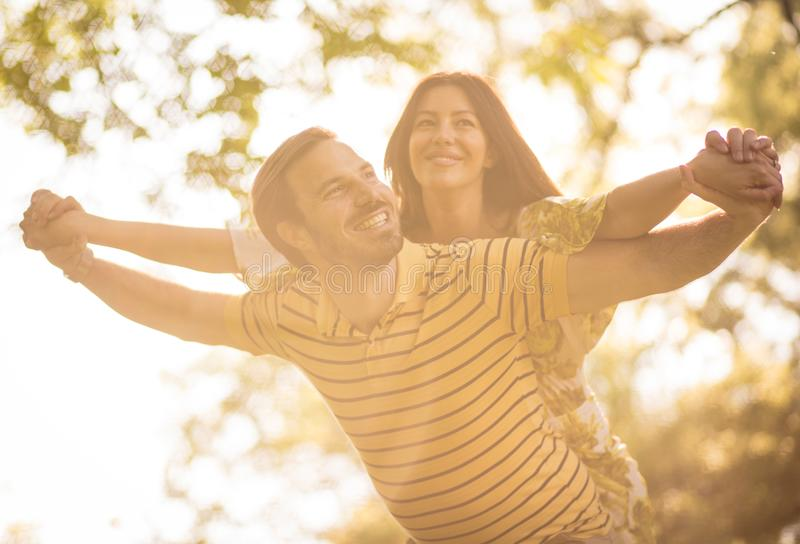 Happy middle age couple have fun at nature. Beauty in nature royalty free stock photo