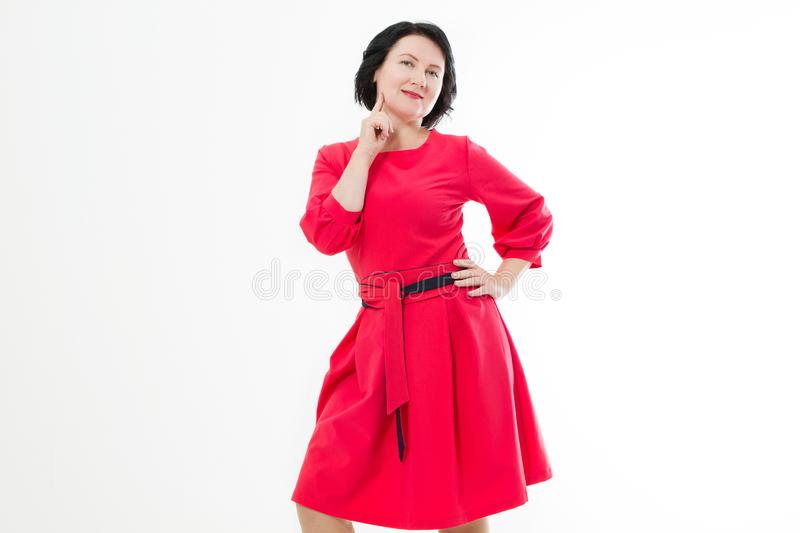 Happy middle age woman in fashion red dress with make up isolated on white background. Copy space.  stock photo