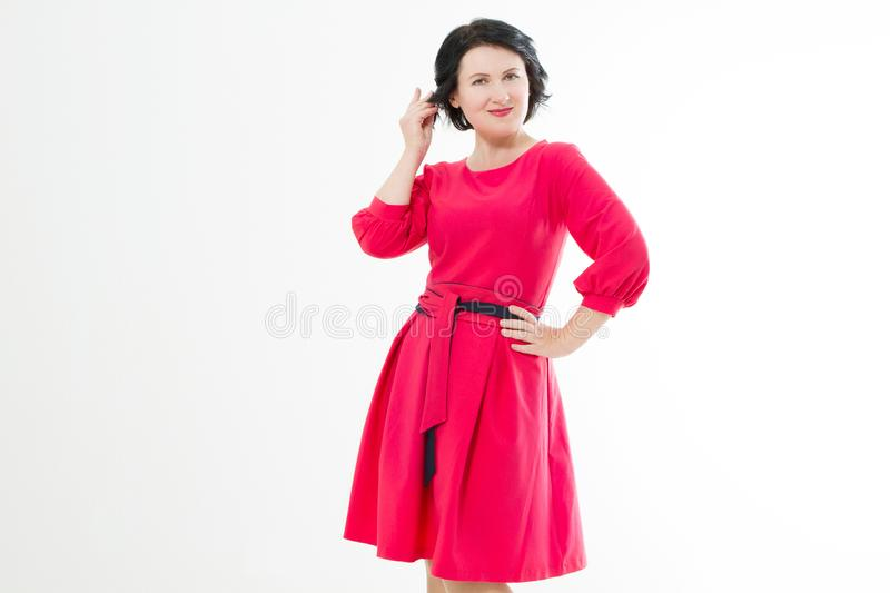 Happy middle age woman in fashion red dress with make up isolated on white background. Copy space.  royalty free stock image