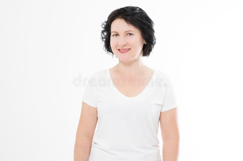 Happy middle age woman in summer blank template t shirt isolated on white background. Copy space.  stock photography