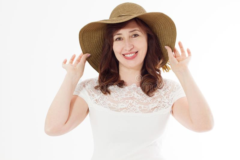 Happy middle age woman in summer hat isolated on white background with copy space. Summertime accessory face wrinkle skin. Protection. Happy menopause. Hot royalty free stock photos