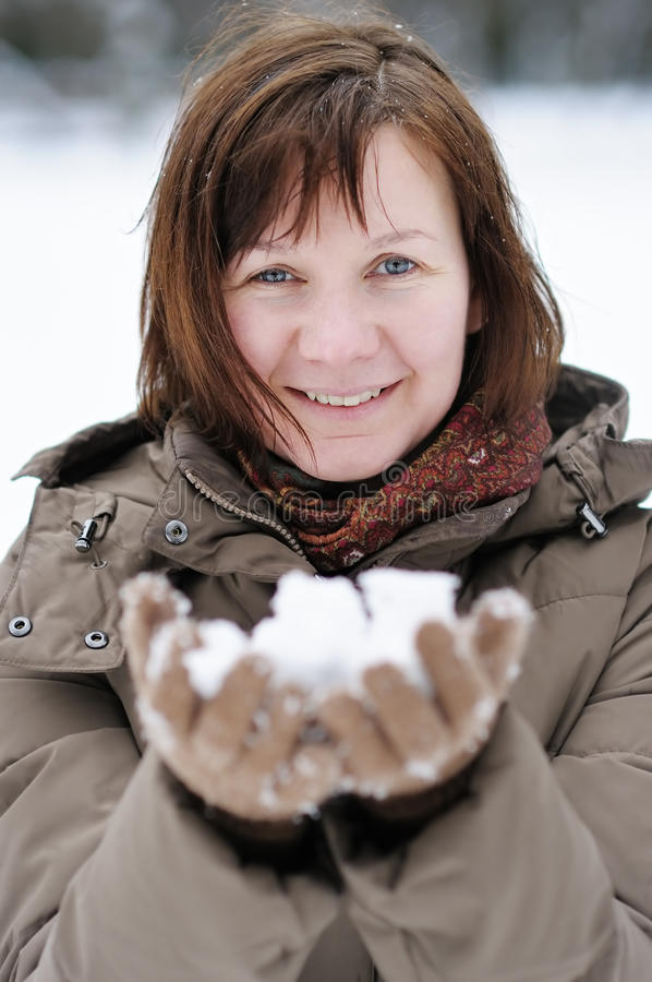 Happy middle age woman in winter. Happy middle age woman having fun in winter royalty free stock photos