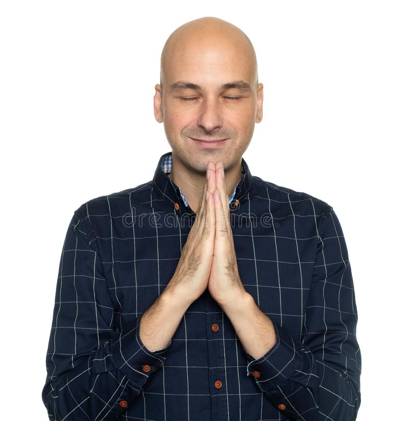 Happy middle aged bald man praying royalty free stock photos