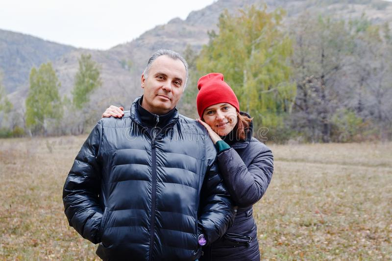 A middle-aged couple in the autumn clothes outdoors stock image