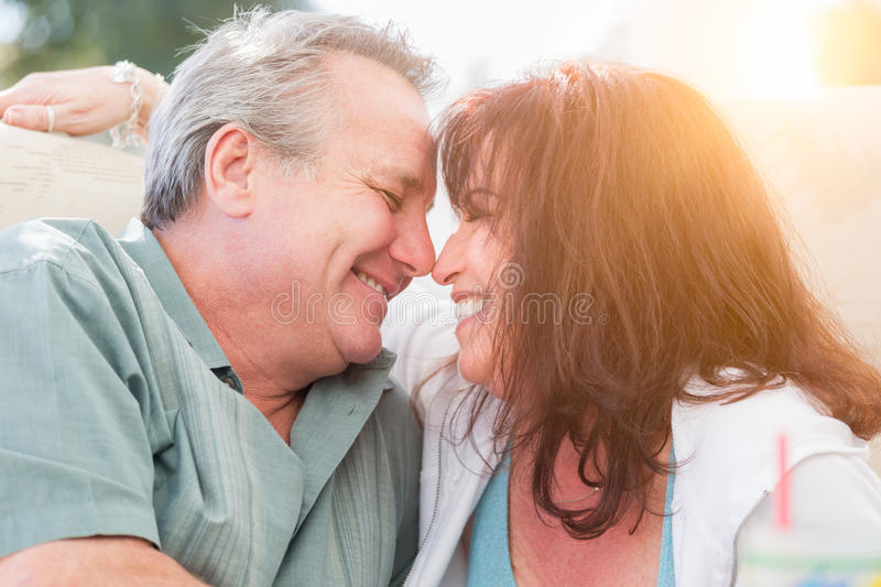 Happy Middle Aged Couple Enjoy A Romantic Moment Outside royalty free stock photos