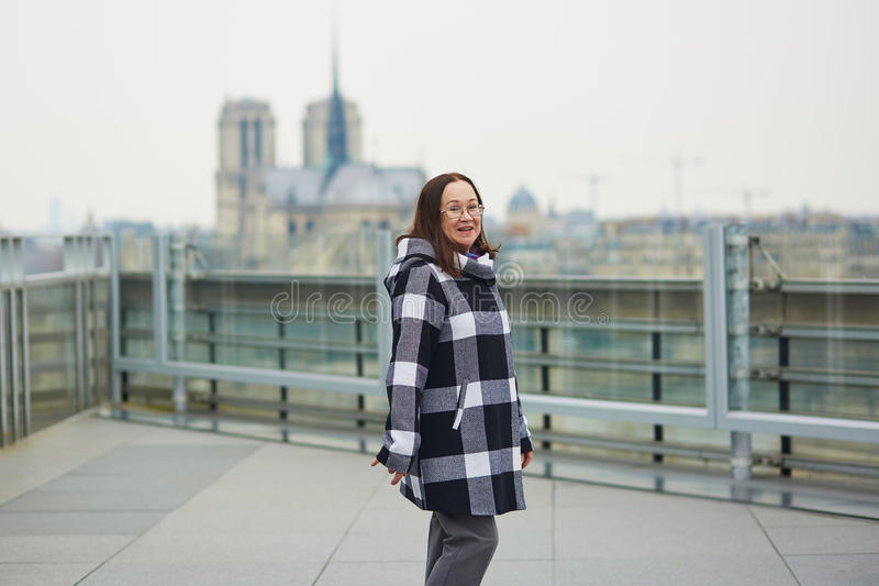 Happy middle aged tourist in Paris. Near Notre-Dame cathedral royalty free stock photography