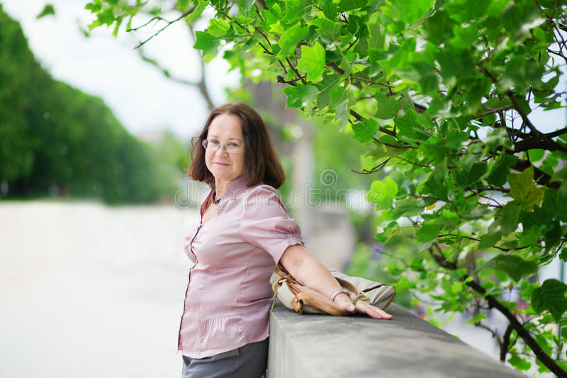 Happy middle aged woman enjoying summer day. Happy middle aged woman enjoying warm summer day royalty free stock images