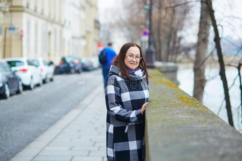 Happy middle aged woman walking in Paris. France stock images