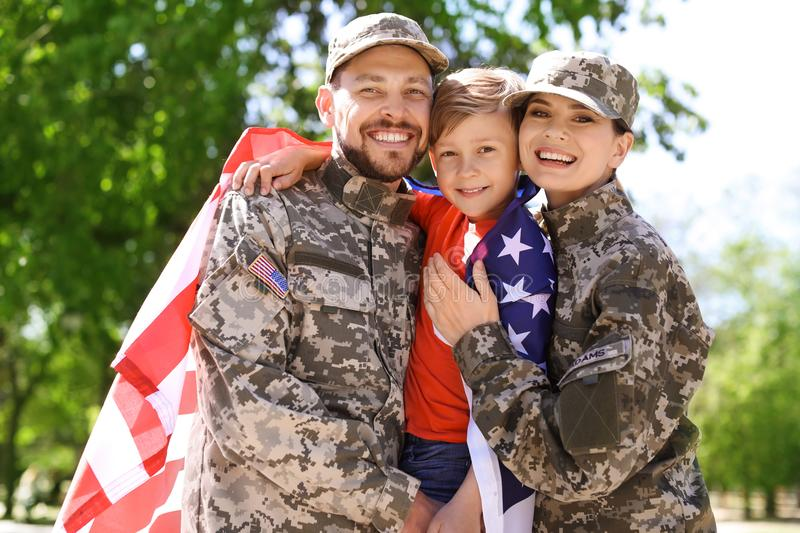 Happy military family with their son, outdoors royalty free stock images