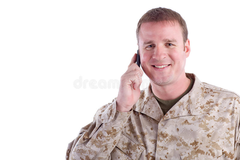 Happy Military Man on Cell Phone royalty free stock image