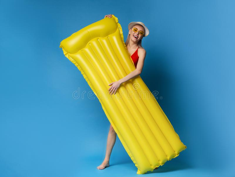 Happy millennial girl holding inflatable mattress, ready to chill out in pool royalty free stock photos