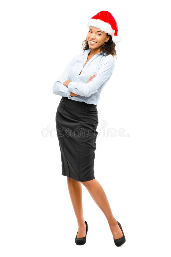 Happy mixed race businesswoman wearing Christmas hat isolated on stock photos