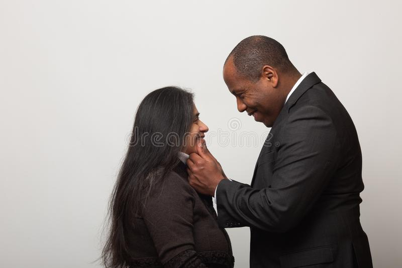 Happy Mixed Race Couple on Light Gray Background stock image