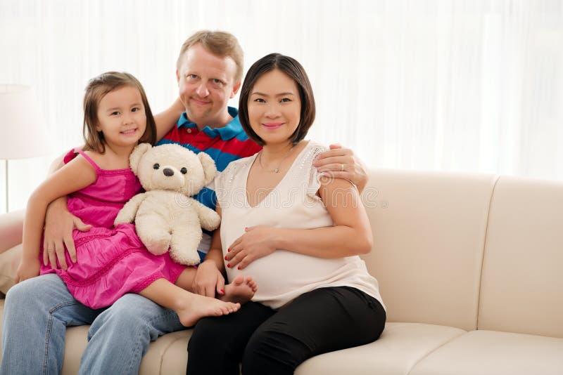 Happy mixed-race family stock image