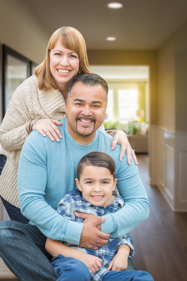 Mixed Race Family Portrait Inside Their New House. Happy Mixed Race Family Portrait Inside Their New House royalty free stock photography