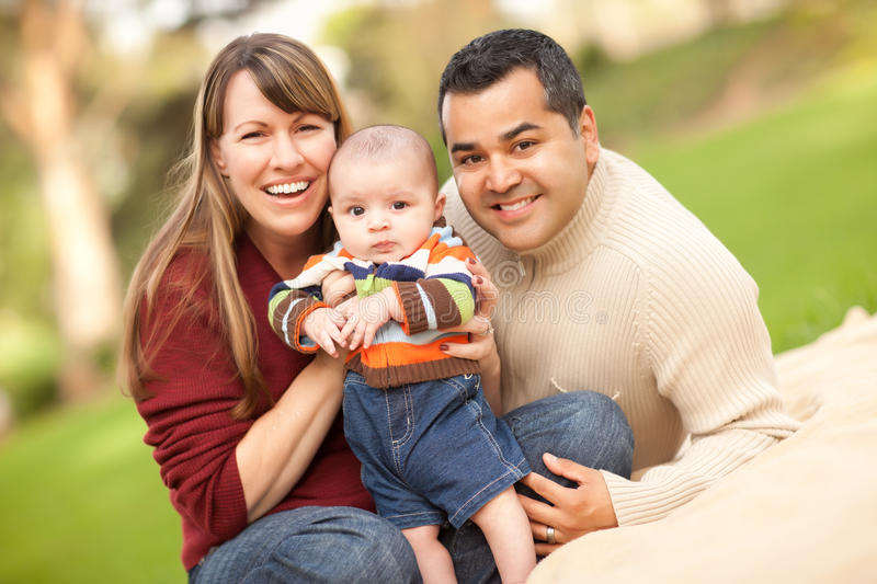 Happy Mixed Race Family Posing for A Portrait stock image