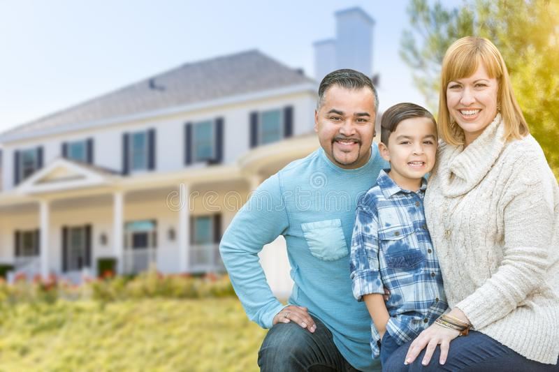 Mixed Race Family Portrait In Front of House. Happy Mixed Race Hispanic and Caucasian Family Portrait In Front of House royalty free stock images