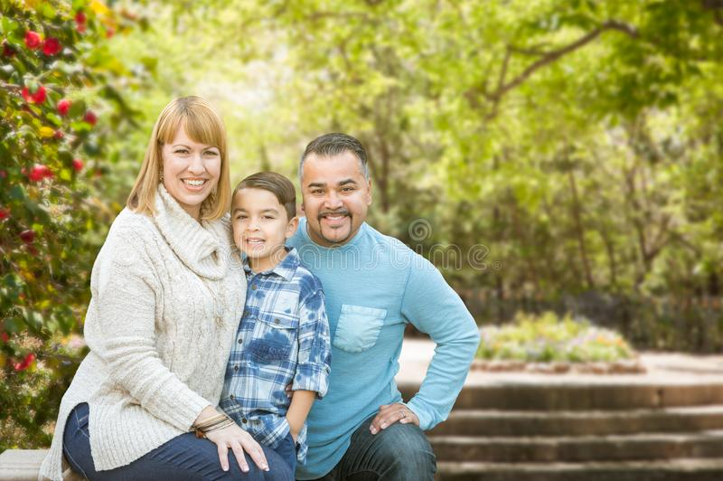 Mixed Race Hispanic and Caucasian Family Portrait at the Park. Happy Mixed Race Hispanic and Caucasian Family Portrait at the Park royalty free stock images