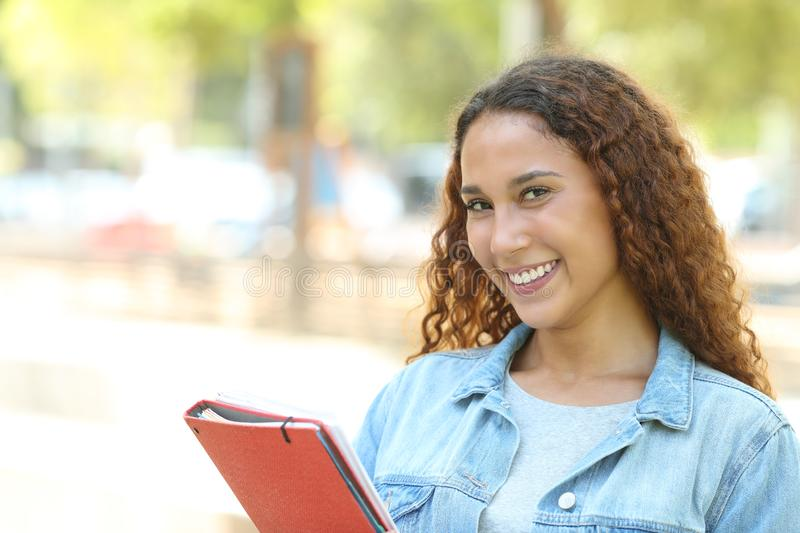 Happy mixed race student posing looking at camera royalty free stock images