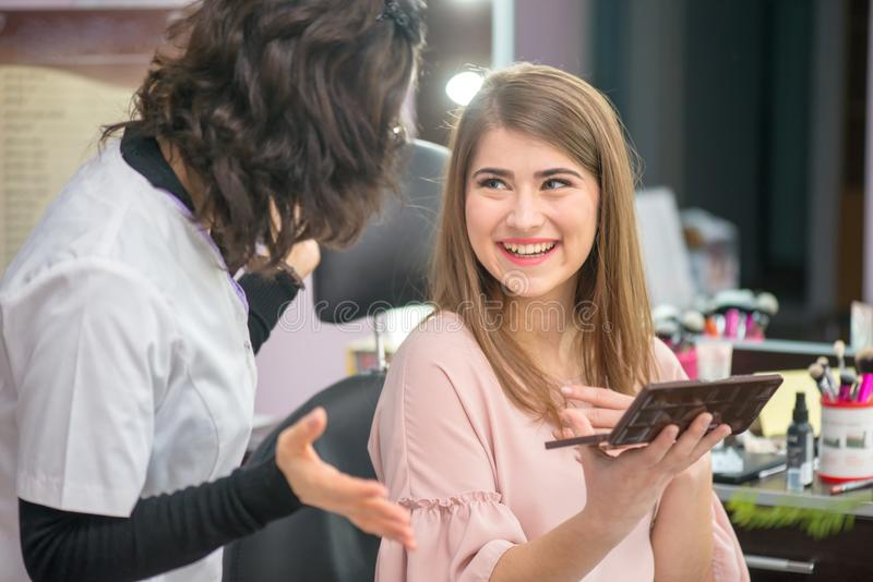 Happy model thanks to her cosmetician royalty free stock image
