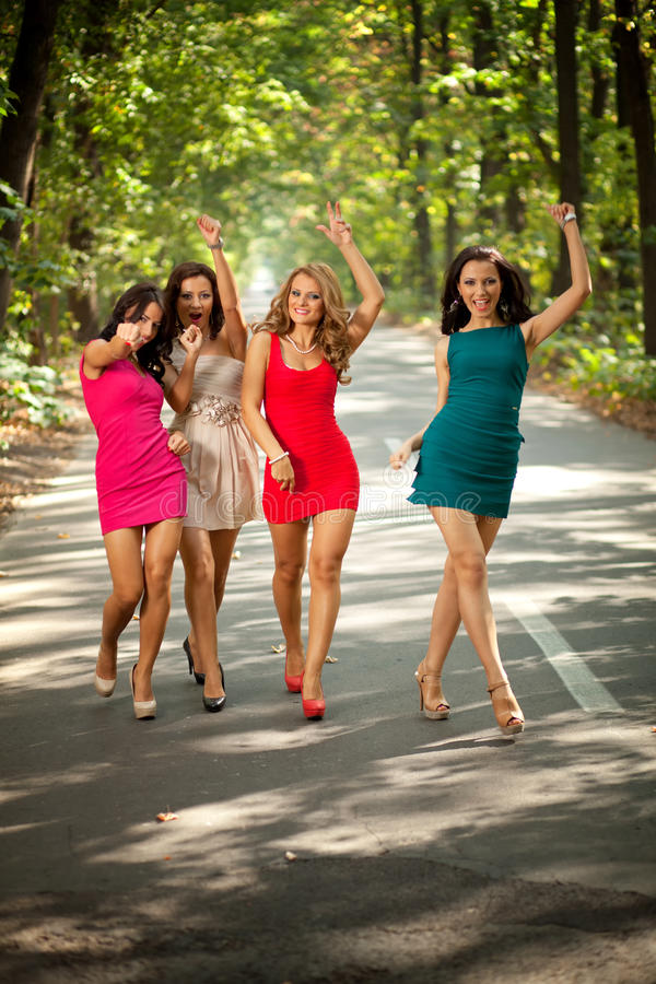 Happy models. Happy group of fashion models in colorful dresses