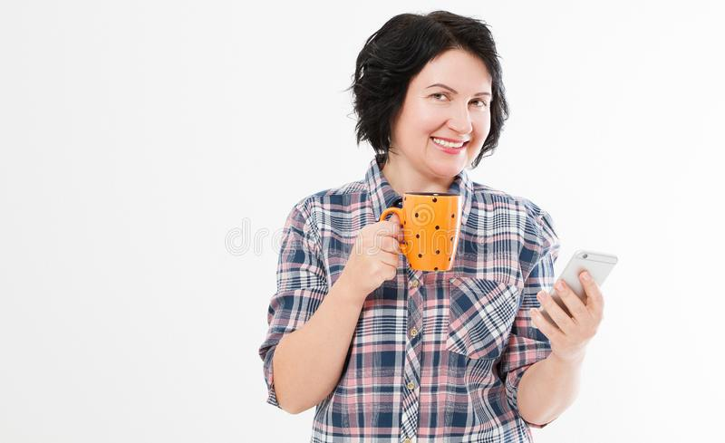 Happy modern middle aged brunette hol hot drink cup and devise isolated stock photography