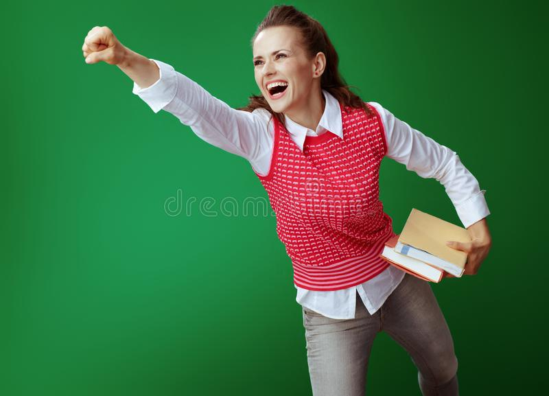 Happy modern student woman with books flying like superhero stock images