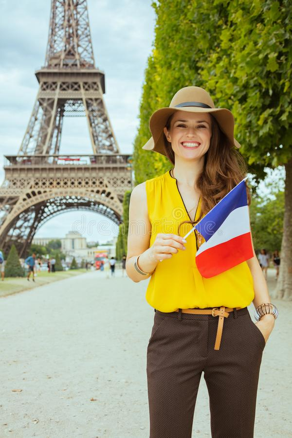Happy modern traveller woman with French flag royalty free stock image