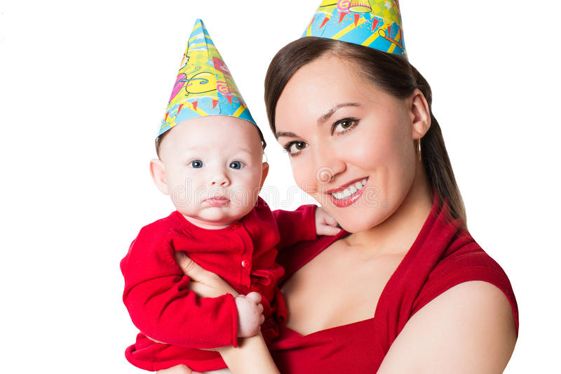 Happy mom and baby celebrating happy birthday royalty free stock photography