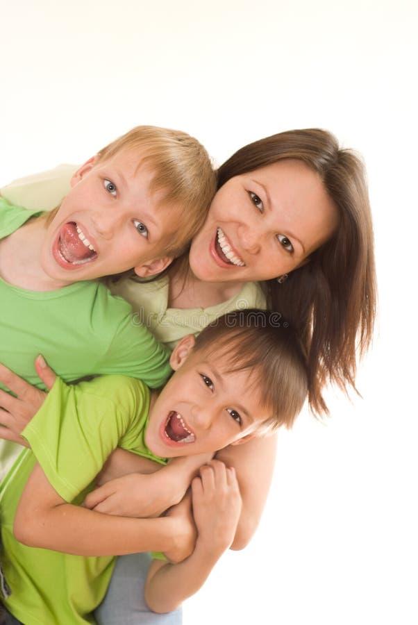 Happy mom and children stock photo
