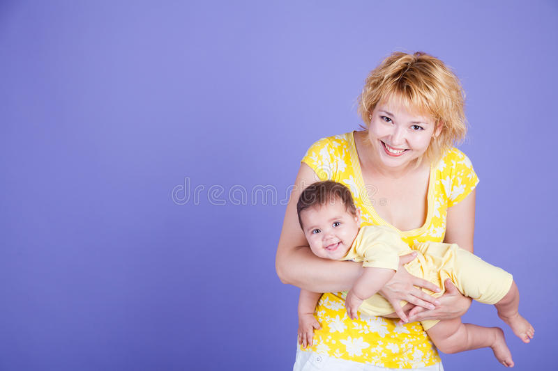 Happy mom and her baby royalty free stock photo