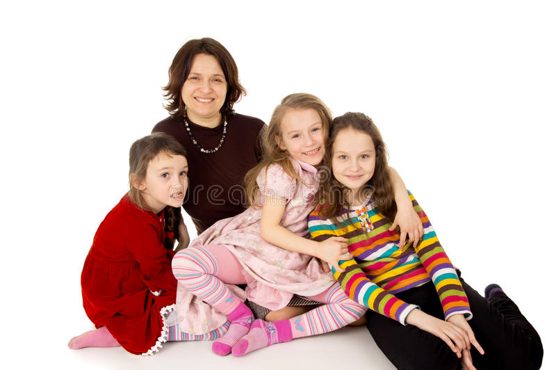 Happy mom with young daughters stock photos