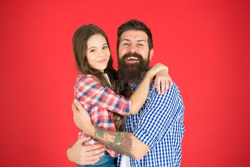 Happy moment. Man bearded father and cute little girl daughter on red background. Celebrate fathers day. Family values stock image