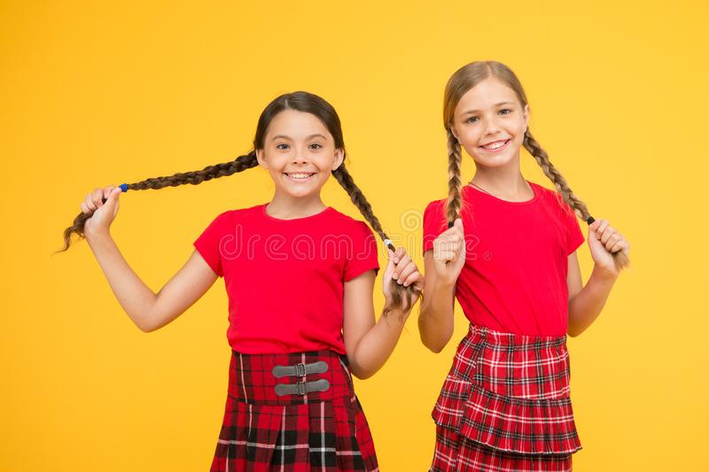 Happy moments. Kids girls sisters best friends in cheerful mood. Beautiful sisters. Children cheerful play with long stock photos