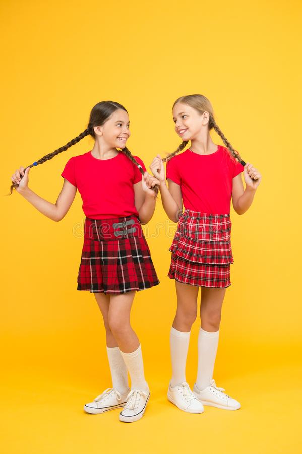 Happy moments. Kids girls sisters best friends in cheerful mood. Strong hair. Grow strong and healthy hair. Hair care royalty free stock images