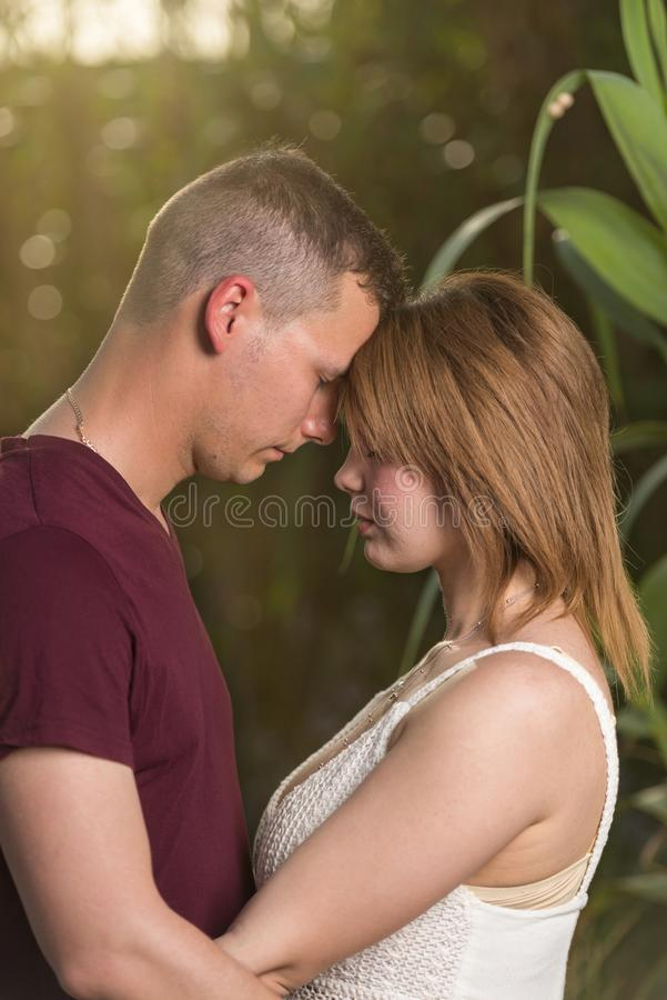Happy moments together. Happy young couple embracing royalty free stock photo